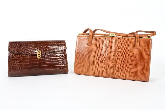 ASPREY: A brown crocodile clutch bag and a lizard bag,