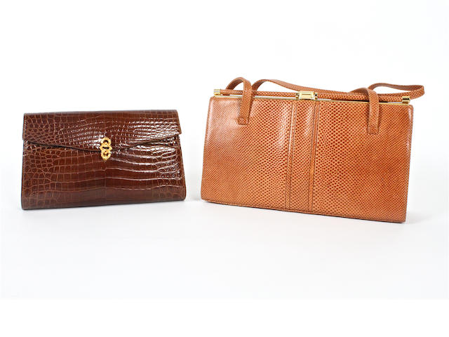 An Asprey brown crocodile clutch bag and a lizard bag