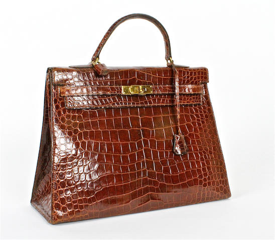 An Hermès brown crocodile Kelly bag