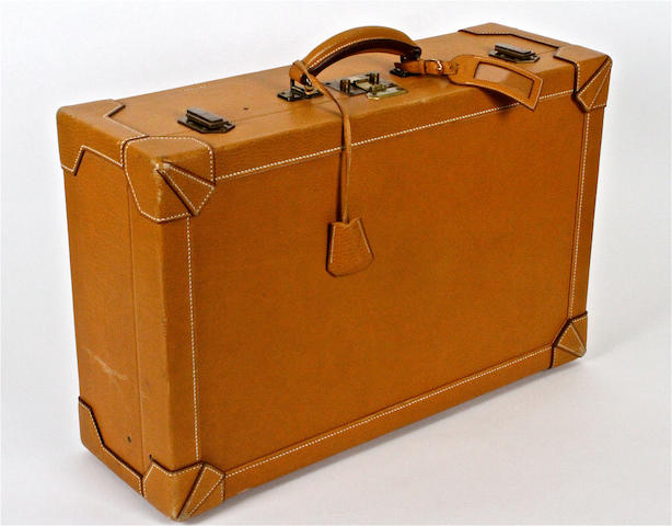 An Hermès leather suitcase