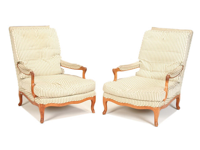 A pair of second quarter 20th century fruitwood armchairs