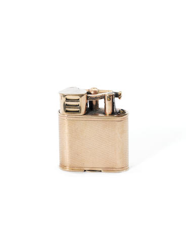 DUNHILL: A  9 carat gold 'Unique' A Sports lighter, by Wise & Greenwood, London 1928,
