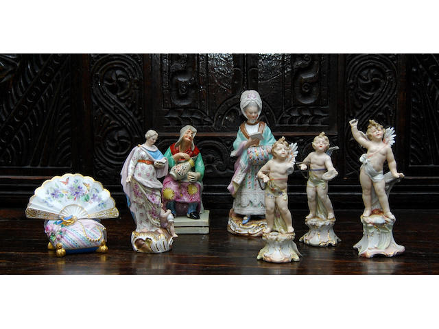 A small collection of Meissen-style figures