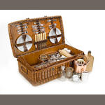 A six-person wicker-cased picnic set, by G W Scott & Sons, c 1909,