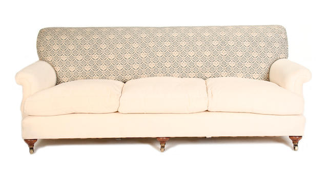 A late Victorian walnut sofa by Howard & Sons