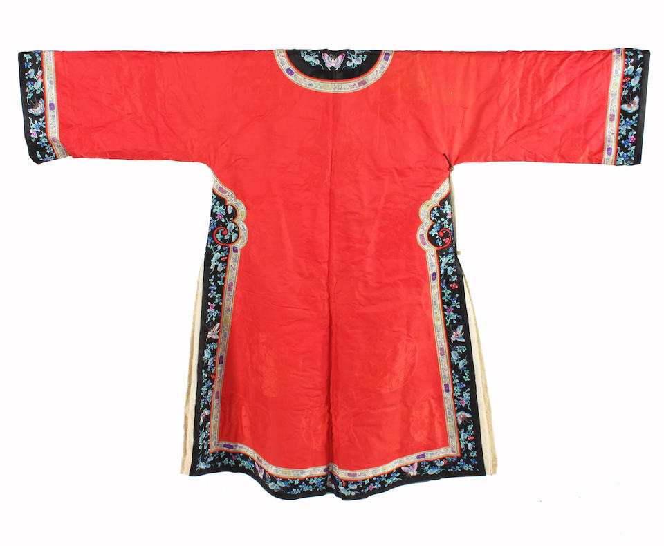 A Chinese late 19th century red silk winter robe