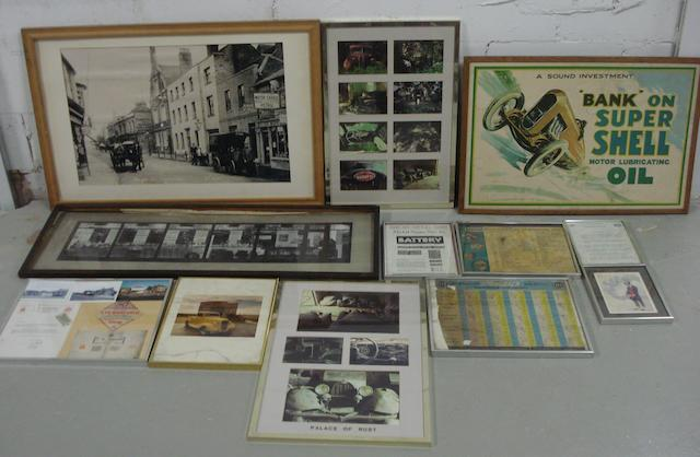 A quantity of framed garage/museum display items,