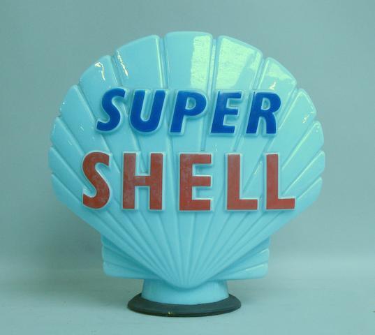Bonhams : A Super Shell blue glass petrol pump globe