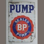 A 'BP Sealed Pump' enamel sign,