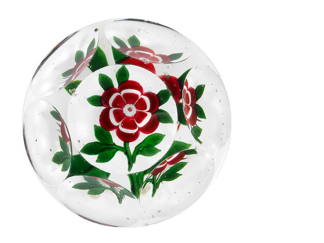 A Baccarat faceted red primrose paperweight, circa 1850