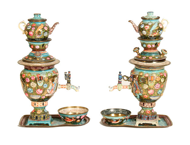 A pair of miniature polychrome enamel samovars together with related items