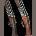 A composed pair of 20-bore (3in) '687 Silver Pigeon V' single-trigger over-and-under ejector guns by P. Beretta, no. N09432S/U67461B In a Beretta leather case