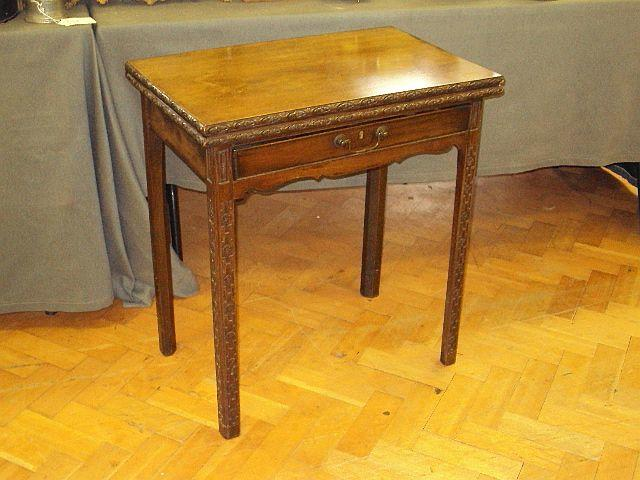 A small mahogany fold-over tea table, in mid-18th Century style