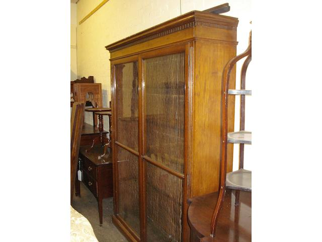 A large late Victorian oak and glazed bookcase