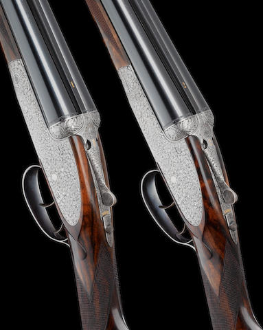 An exceptional pair of S.J. Kelly-engraved 20-bore (2¾in) self-opening sidelock ejector guns by J. Purdey & Sons, no. 30295/6 In their leather motor-case with canvas cover