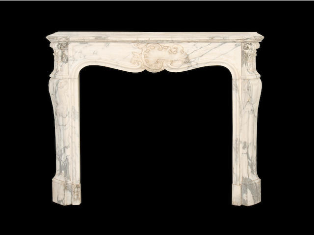 A late 19th century Louis XV style carved marble chimneypiece