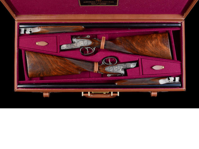A fine pair of Bimendi-engraved 20-bore (2¾in) self-opening sidelock ejector guns by Aguirre & Aranzabal, no. 541-96/542-96 In their leather case with canvas cover