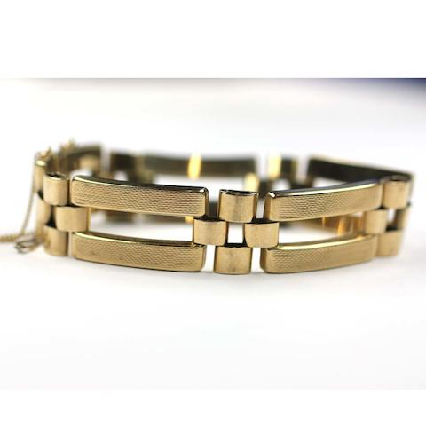 A  9ct gold fancy link bracelet by Smith and Pepper