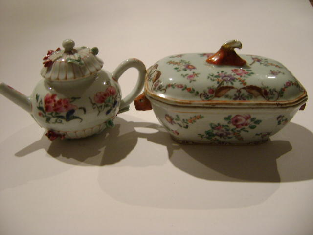 A Chinese famille rose teapot and cover,modelled iwth lotus, 10cm high, together with a famille rose sauce tureen and cover. (2)
