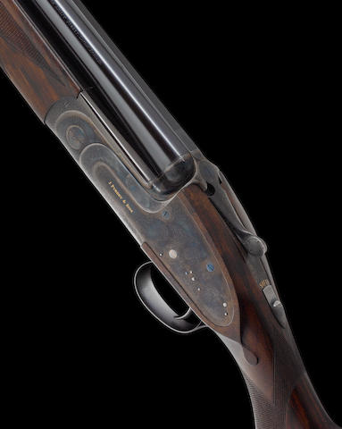 A fine 12-bore (2¾in) single-trigger over-and-under sidelock ejector gun by J. Purdey & Sons, no. 29470 In its leather case together with makers accessories, comprising two-piece cleaning-rod, horn snap caps, nickel-plated square oil bottle and striker pot with spare strikers, two turnscrews with turned swelling wooden handles, brass cartridge extractor and cleaning brushes
