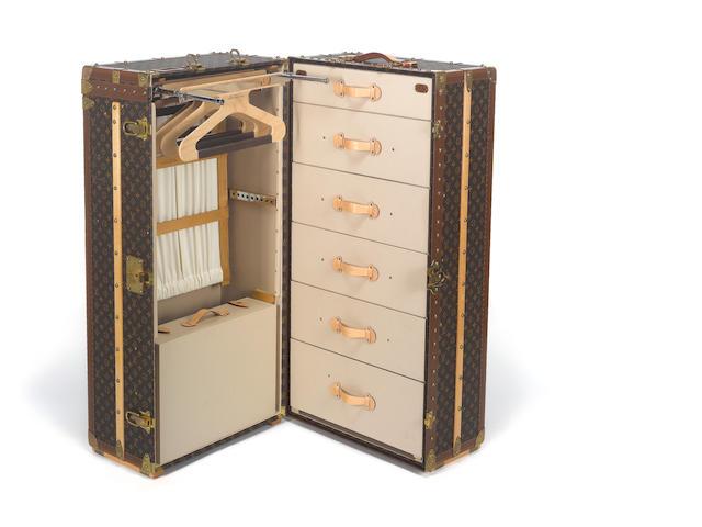 LOUIS VUITTON: A travelling cabin / wardrobe trunk,