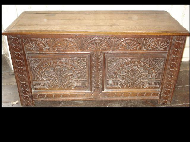 An early 18th Century carved oak coffer,