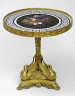 An Imperial Russian gilt-bronze centre table, the marble top with a lapidary relief bouquetImperial Lapidary Factory in Peterhof, design by Joseph August Satory (1803-1868), bronze mounts by Nichols and Plincke English Shop  1842