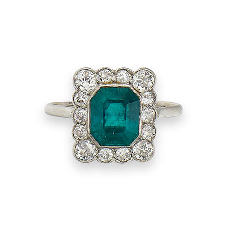 An early 20th century emerald and diamond cluster ring