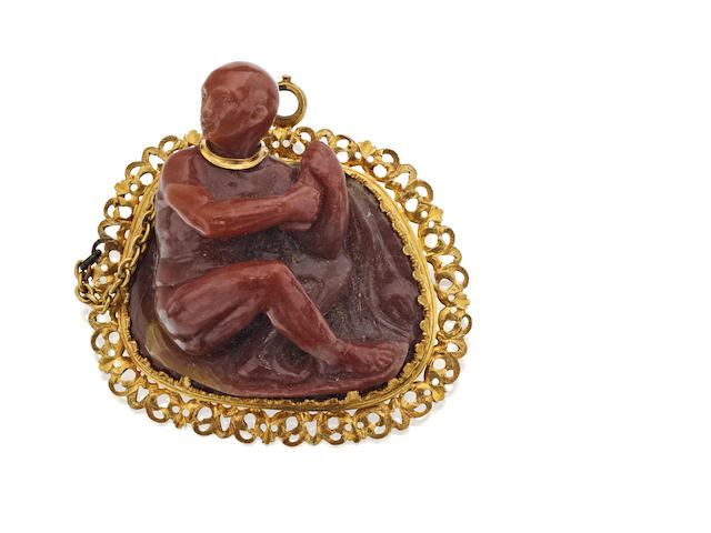An unusual 19th century carved agate 'slave' brooch