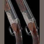 A fine pair of 20-bore (2¾in) 'Kennedy Game' single-trigger over-and-under ejector guns by Perugini & Visini, no. 2998/9 The whole in a Negrini plastic case with Perugini & Visini stock screwdriver