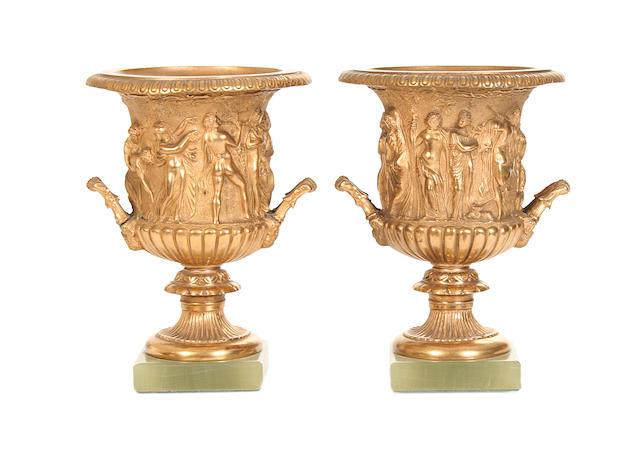 A pair of gilt metal Campana urns