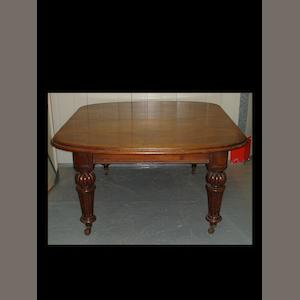 A Victorian mahogany extending dining table and three leaves