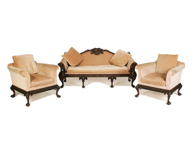 A good early 20th century carved mahogany sofa and pair of en-suite armchairs by Maples after a design by Robert Adam or John Linnell