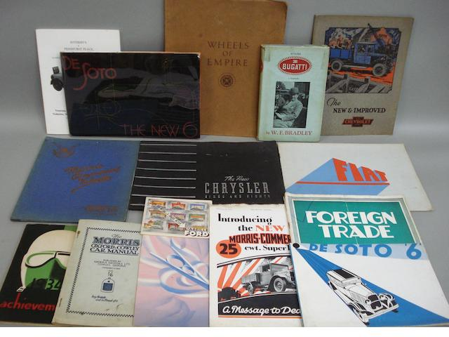 A lot of motor car sales brochures,