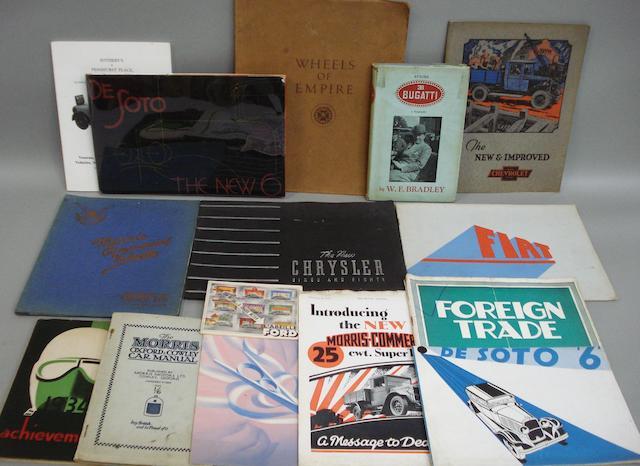A lot of motor car sales brochures,