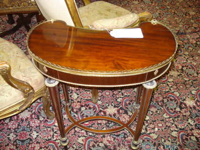 A Louis XVI style mahogany and gilt metal mounted side table