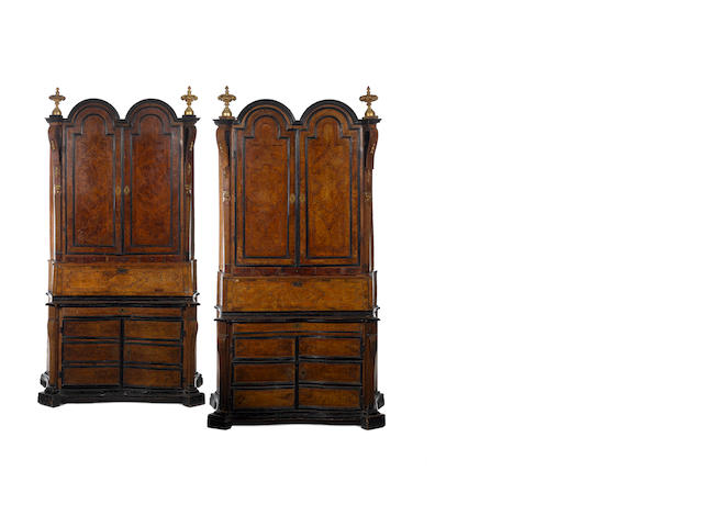 A rare pair of North Italian second-quarter 18th century parcel-gilt, walnut, burr-walnut, olivewood, ebonised and parquetry double-domed bureau-cabinets