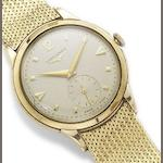 Longines. A 9ct gold manual wind wristwatch on associated 18ct gold bracelet Hallmarked London 1953