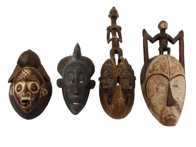 Four various African masks largest 63cm high 4