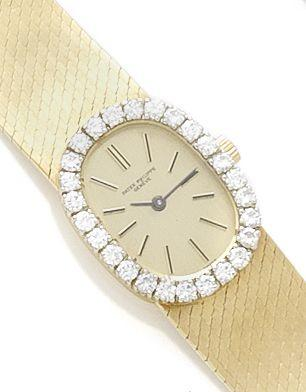 Patek Philippe. A lady's 18ct gold manual wind wristwatch with diamond bezel Circa 1990