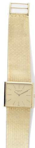 Patek Philippe. An 18ct gold manual wind bracelet watch Ref. 3549