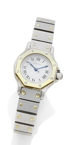 Cartier. A lady's stainless steel and gold automatic wristwatch Santos, recent