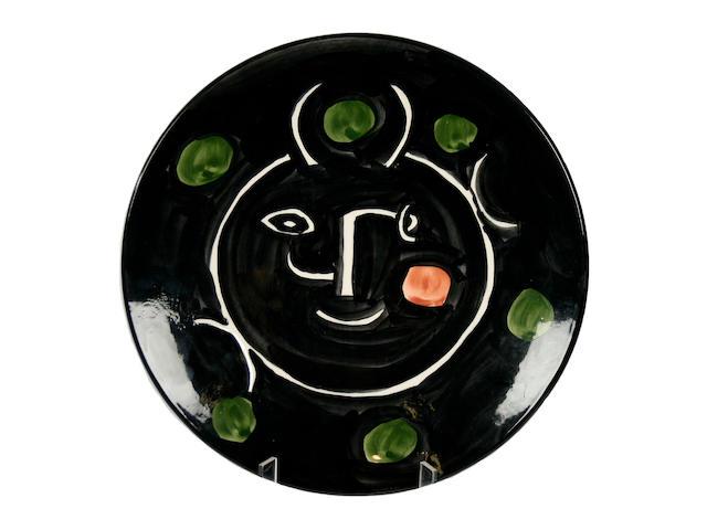 A Madoura limited edition Picasso plate 'Service Visage Noir' Circa 1948