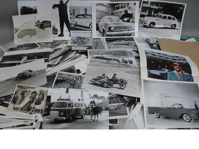 A quantity of photographs depicting post War road cars,