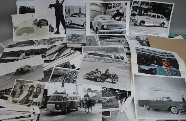 A quantity of photographs depicting post War road cars,