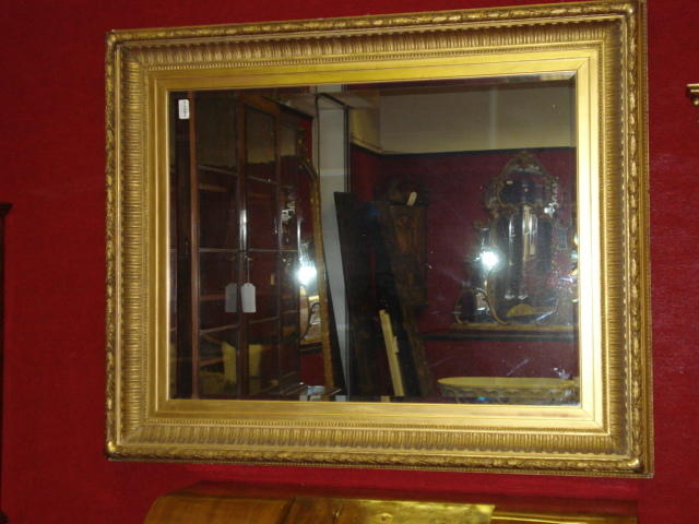 A large late 19th century giltwood and composition picture frame