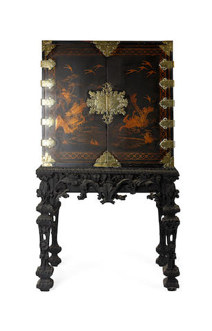 A 17th century Japanese-export black lacquered and gilt cabinet on stand