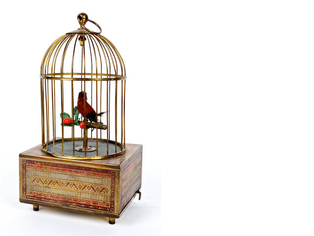 A small singing bird in cage, for the Eastern market, circa 1950,