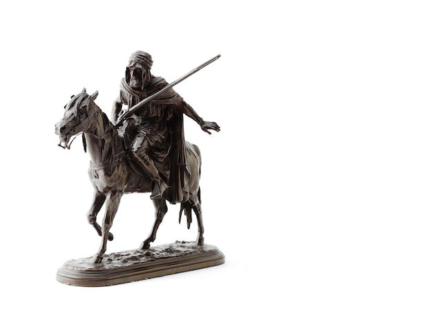 A bronze figure group of an Arab warrior on horseback
