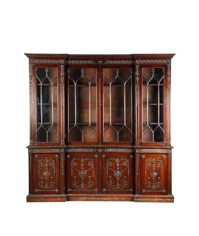 A late 19th of early 20th century mahogany inverted breakfront bookcase Of George III design